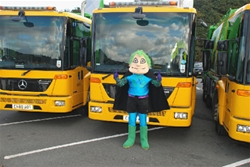 Mascot standing in front of Recycling Lorries