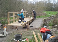 Students help to replace bridges at Parc y Llyn